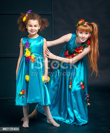 istock Portrait of Two Girls in Turquoise Dresses 882125404