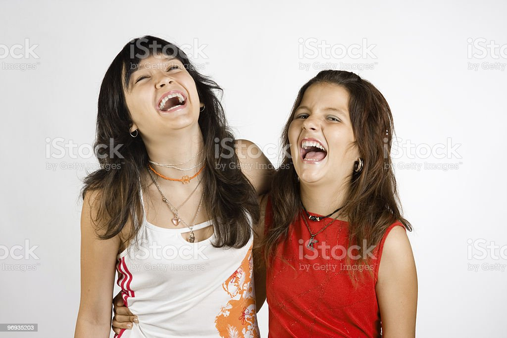 Portrait of two laughing girls royalty-free stock photo