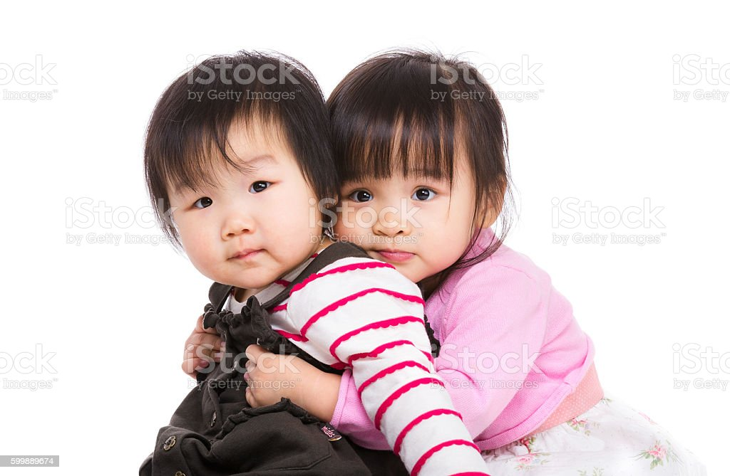 Portrait of two little Chinese girls stock photo