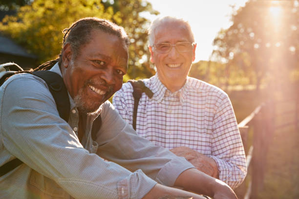 Portrait Of Two Male Senior Friends Hiking In Countryside stock photo