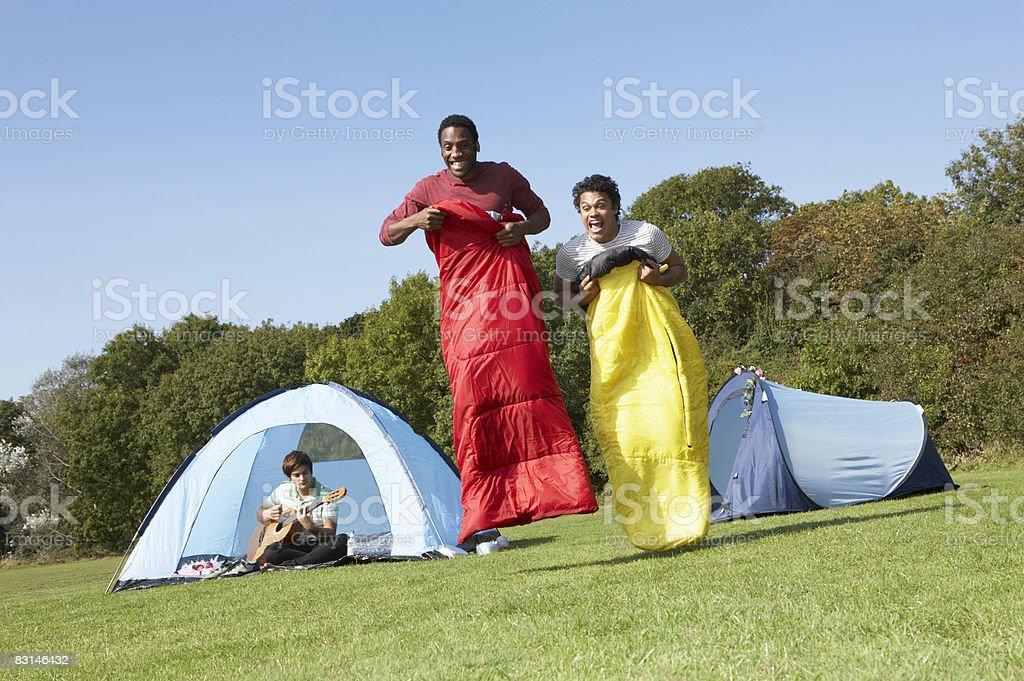 Portrait of two men racing in sleeping bags royalty free stockfoto