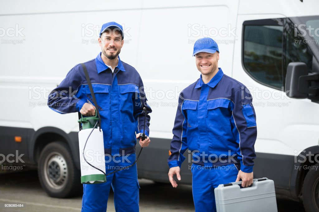 Portrait Of Two Pest Control Workers stock photo