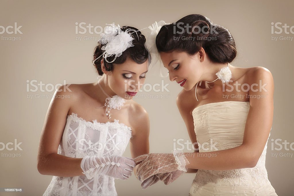 Portrait of Two Retro-Styled Brides in Luxury Wedding Dresses. royalty-free stock photo