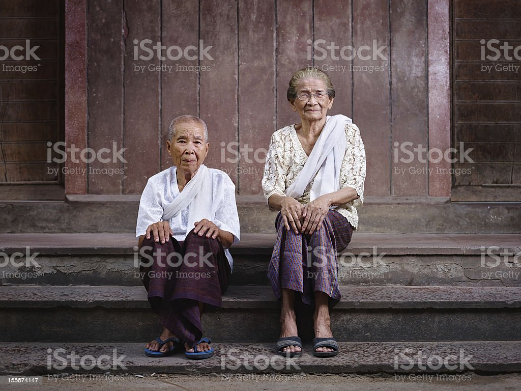 Portrait of two senior asian women looking at camera royalty-free stock photo
