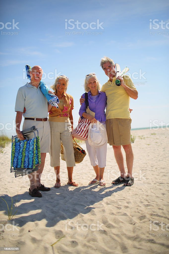Portrait of two senior couples on vacation at beach royalty-free stock photo