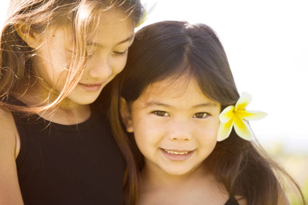 Portrait of Two Sister Young girl Hawaiian Polynesian Children stock photo
