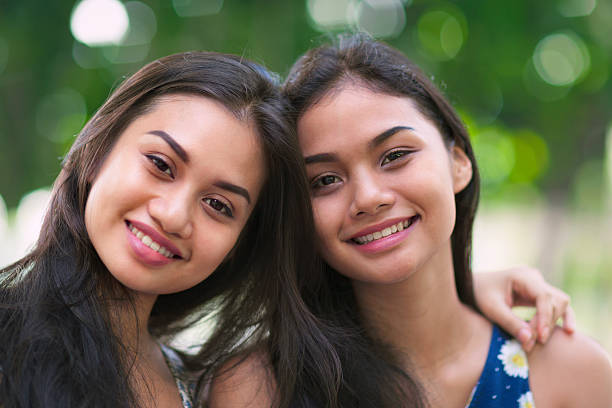 portrait of two sisters - philippines girl stock photos and pictures