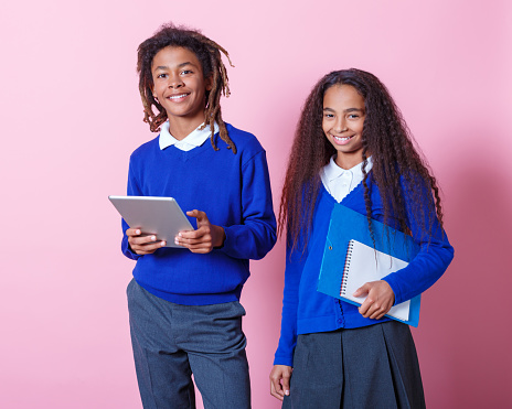 Portrait Of Two Smiling Afro Amercian Teenage Students Stock Photo - Download Image Now