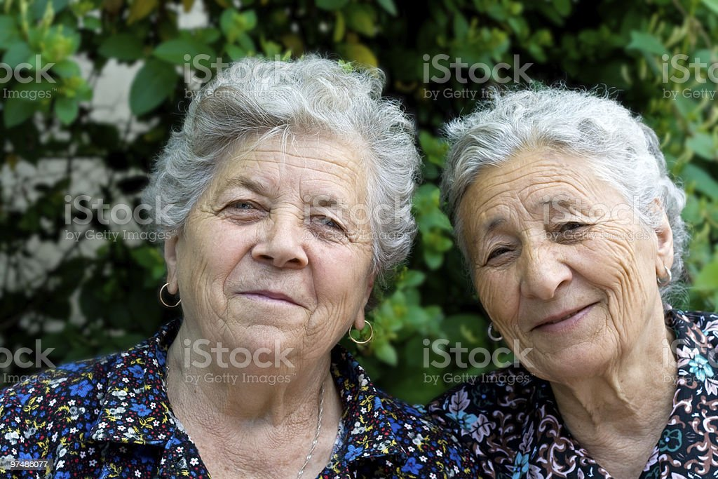 Portrait of two smiling old ladies royalty-free stock photo