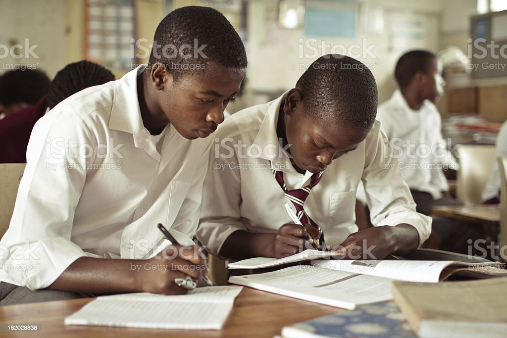 Portrait of two South African boys studying in rural classroom stock photo