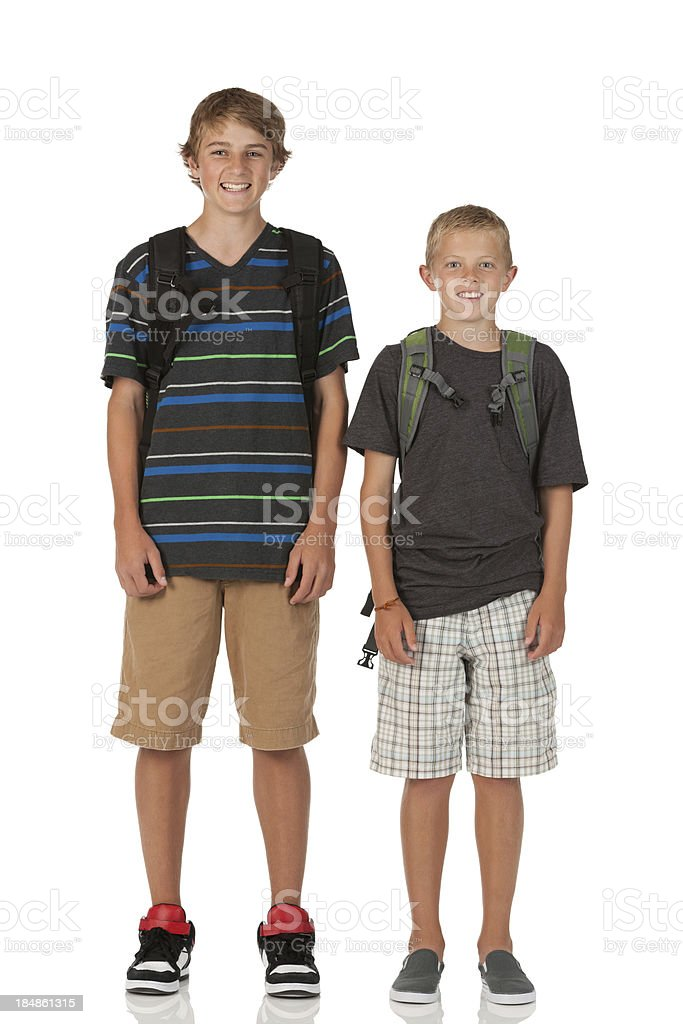 Portrait of two teenage boys with backpacks royalty-free stock photo