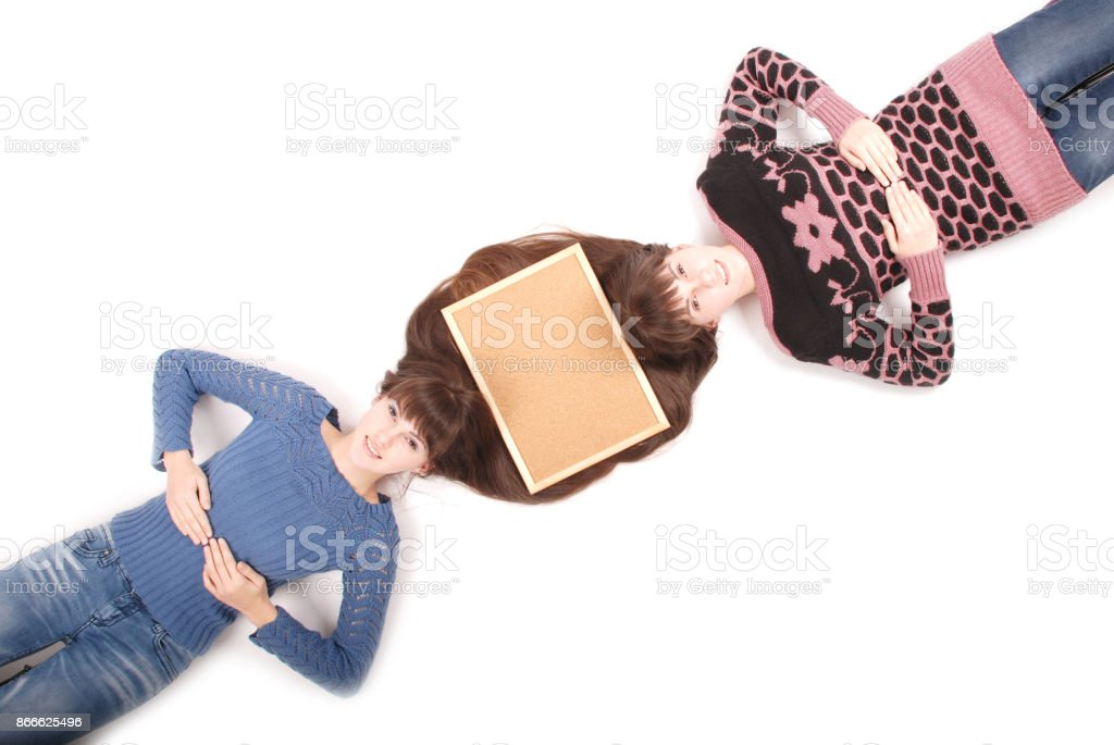 Portrait Of Two Twins Sisters With Long Hair And Cork Board Stock Photo Download Image Now Istock