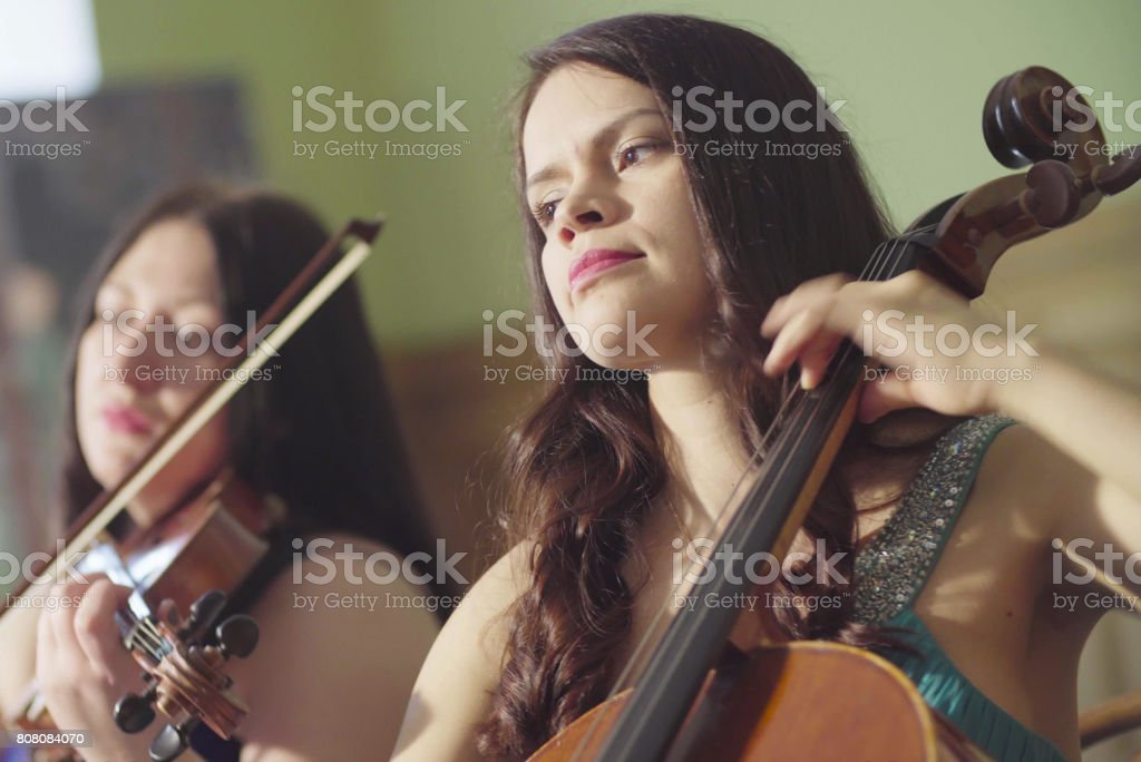 Portrait of two women playing music stock photo