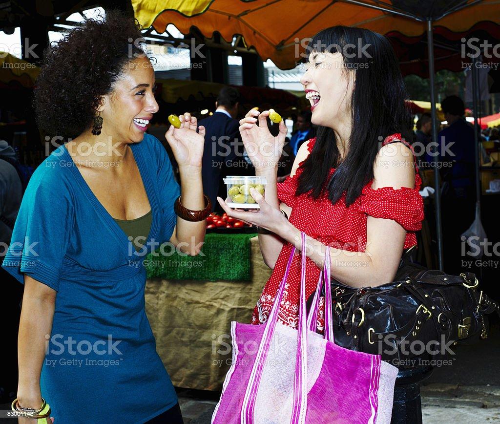 Portrait of two women sharing olives zbiór zdjęć royalty-free