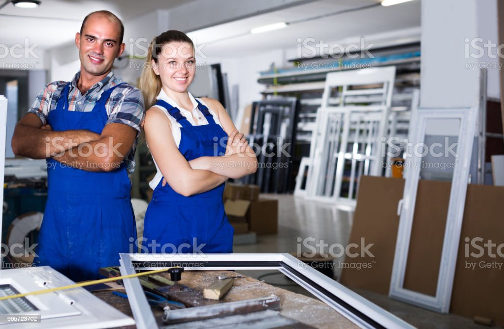 Portrait of two workers who are working at workshop - Royalty-free Accuracy Stock Photo