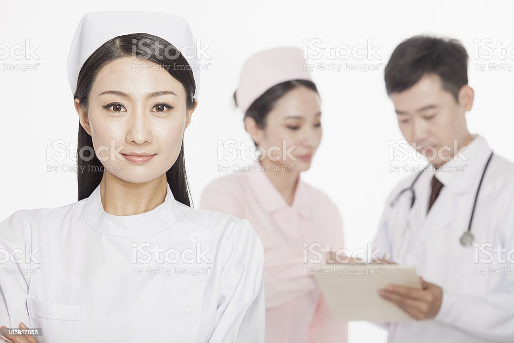 Portrait of two young nurses and doctor, studio shot royalty-free stock photo