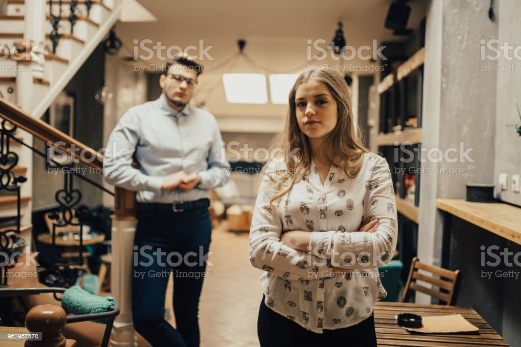 Portrait of two young people in the coffee shop