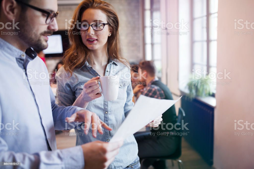 Portrait of two young perspective designers discussing royalty-free stock photo