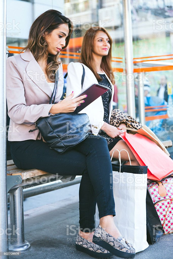 Portrait Of Two Young Women At The Tram Stop stock photo