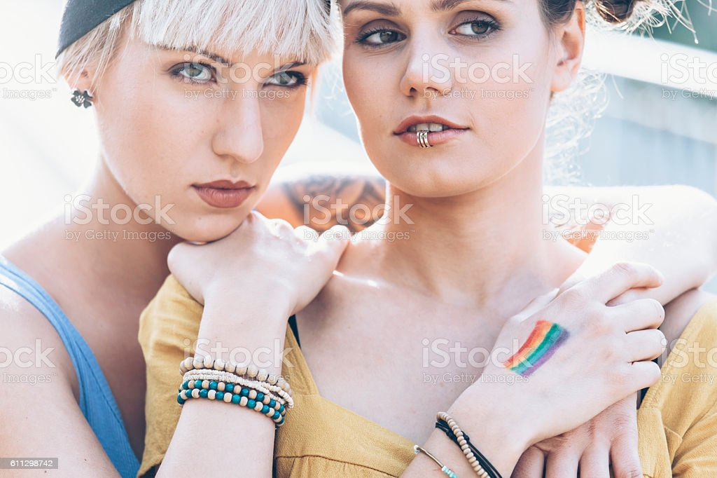 Portrait of two young women standing face to face stock photo