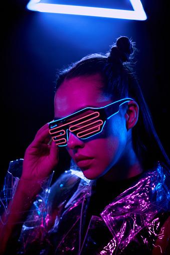 Ultramodern girl adjusting flashing goggles