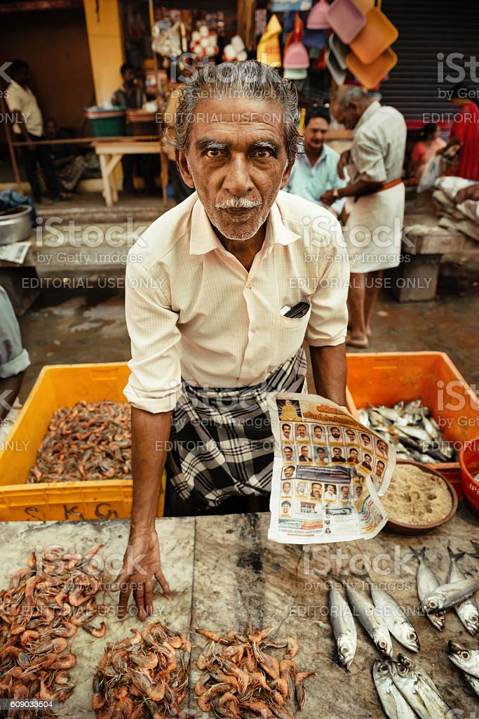 Portrait of unidentified Indian man on the fish market stock photo