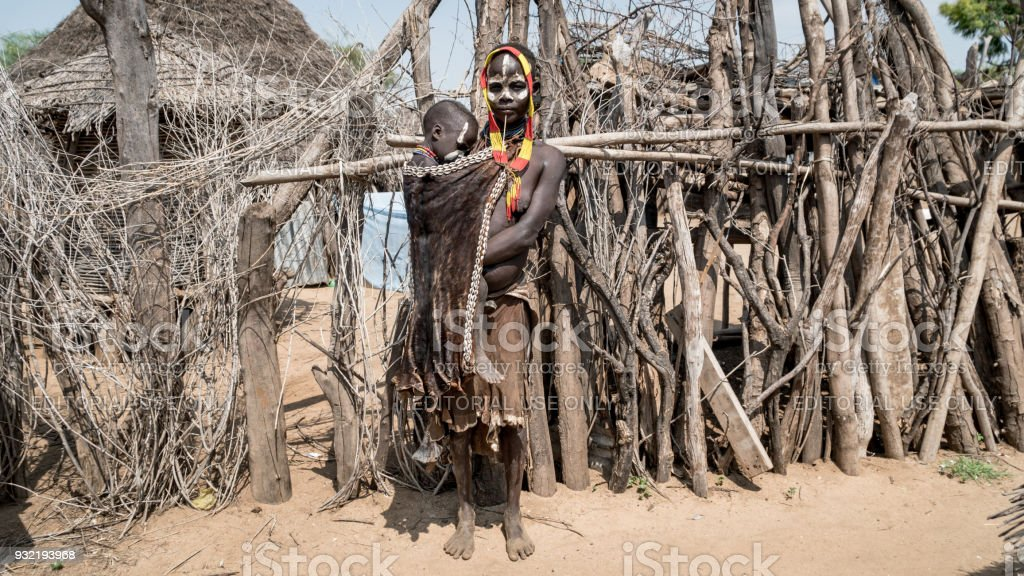 Portrait of unidentified Karo tribe woman with her child, Colcho, Omo Valley, Ethiopia. stock photo