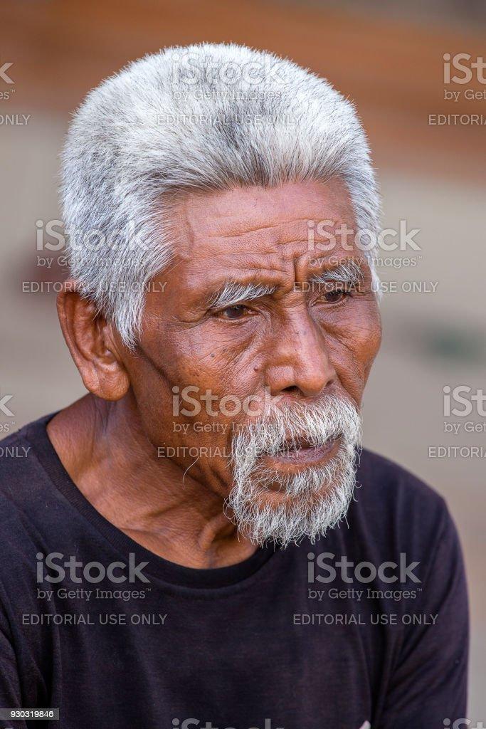 Portrait of unidentified man on local market in Bali island, Indonesia stock photo