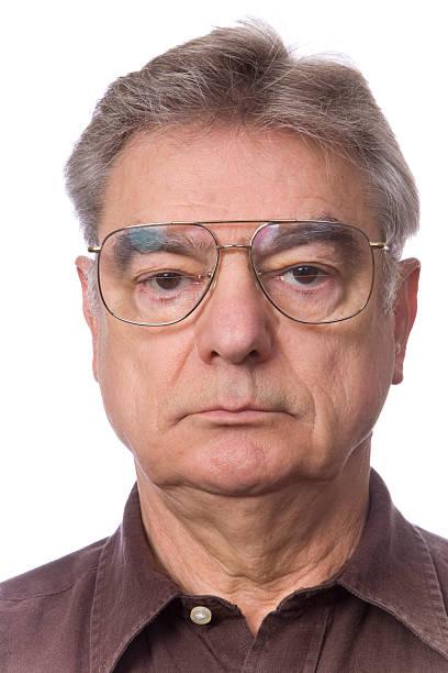Portrait of Unsmiling Mature Man stock photo
