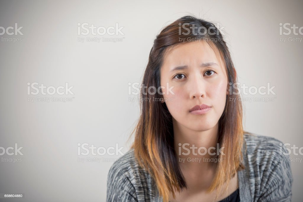 Portrait of upset Asian woman stock photo
