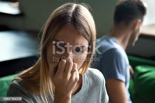 istock Portrait of upset offended frustrated woman with man 1063760026