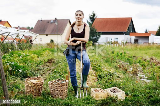 A portrait of an urban farmer Standing Proudly With Her Day