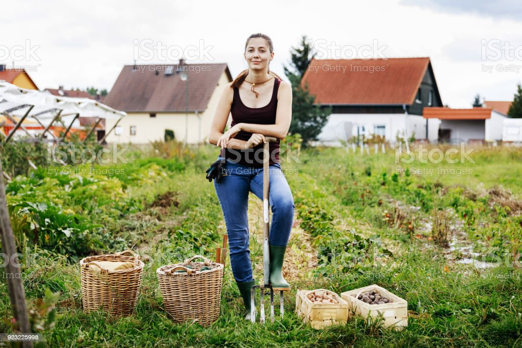 Portrait Of Urban Farmer Standing With Days Harvest stock photo