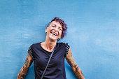 Portrait of urban Italian tattooed woman on the street