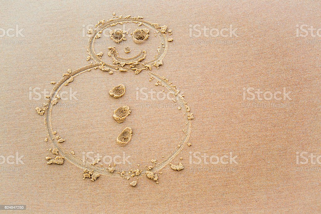 Portrait of very nice, smiling snowman drawn wet sand. Background. stock photo