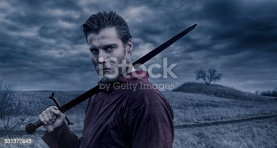 istock Portrait of Viking warrior holding a sword 531372643