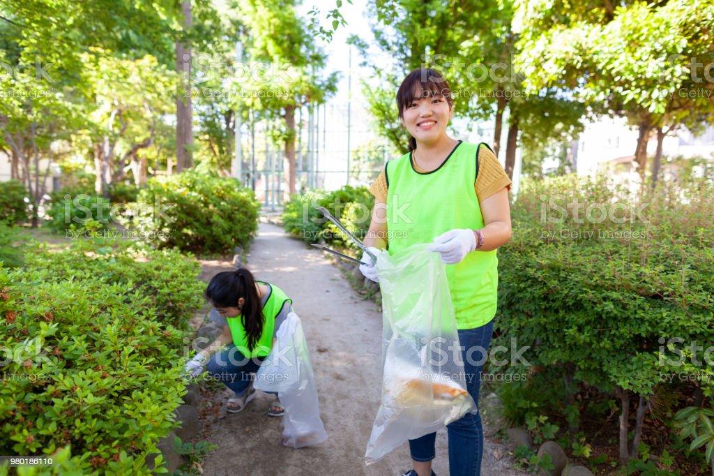 Portrait of volunteer in public park stock photo