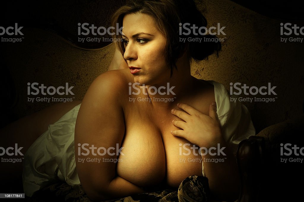 Portrait of Voluptuous Woman and Holding Her Cleavage royalty-free stock photo