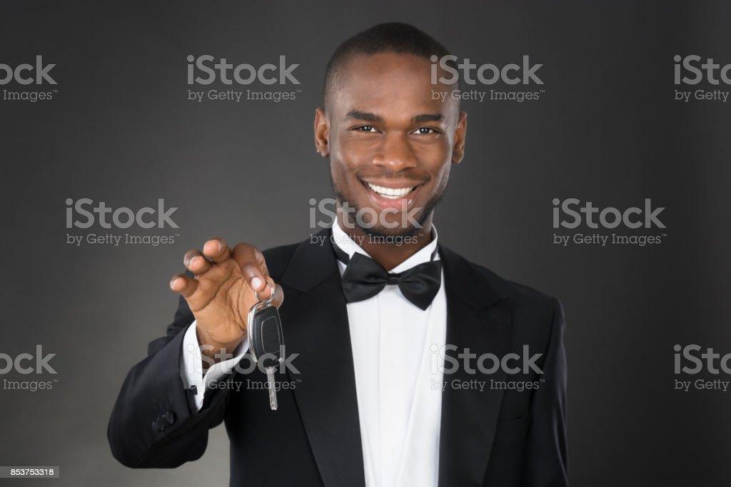 Portrait Of Waiter Holding Car Key stock photo
