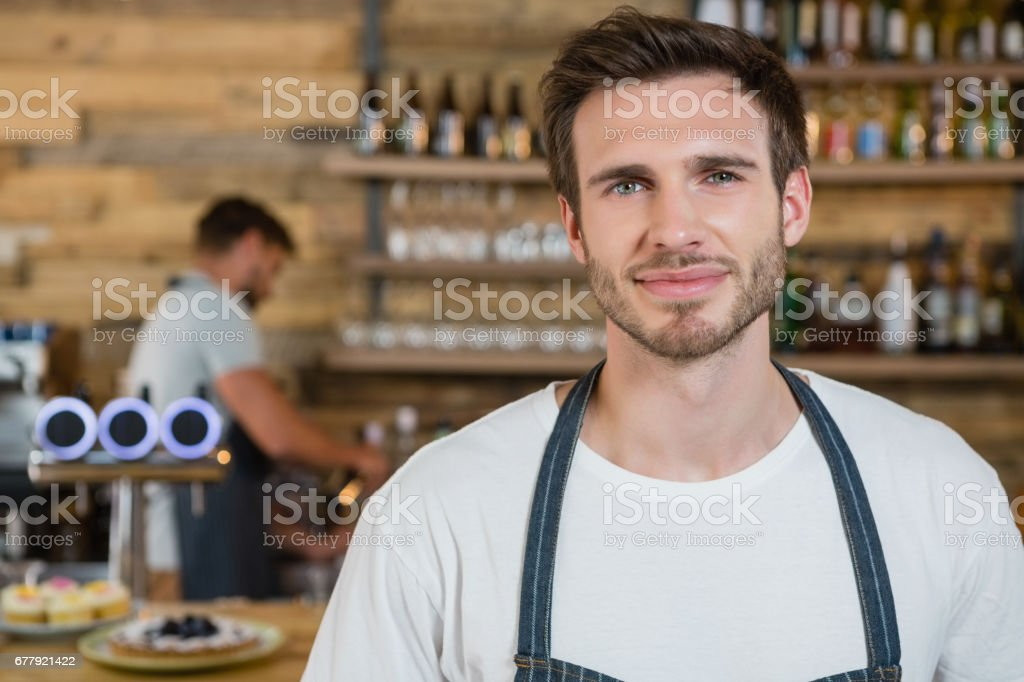 Portrait of waiter standing behind the counter royalty-free stock photo