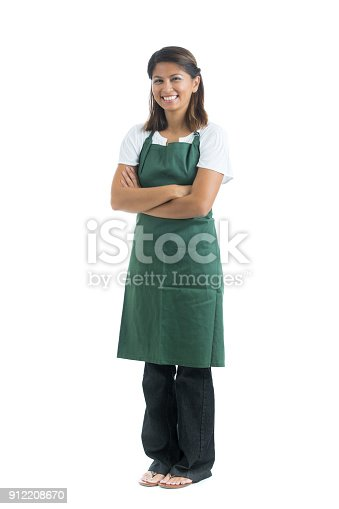 Beautiful female waitress stands with her arms crossed. Photo is taken in front of a white background.