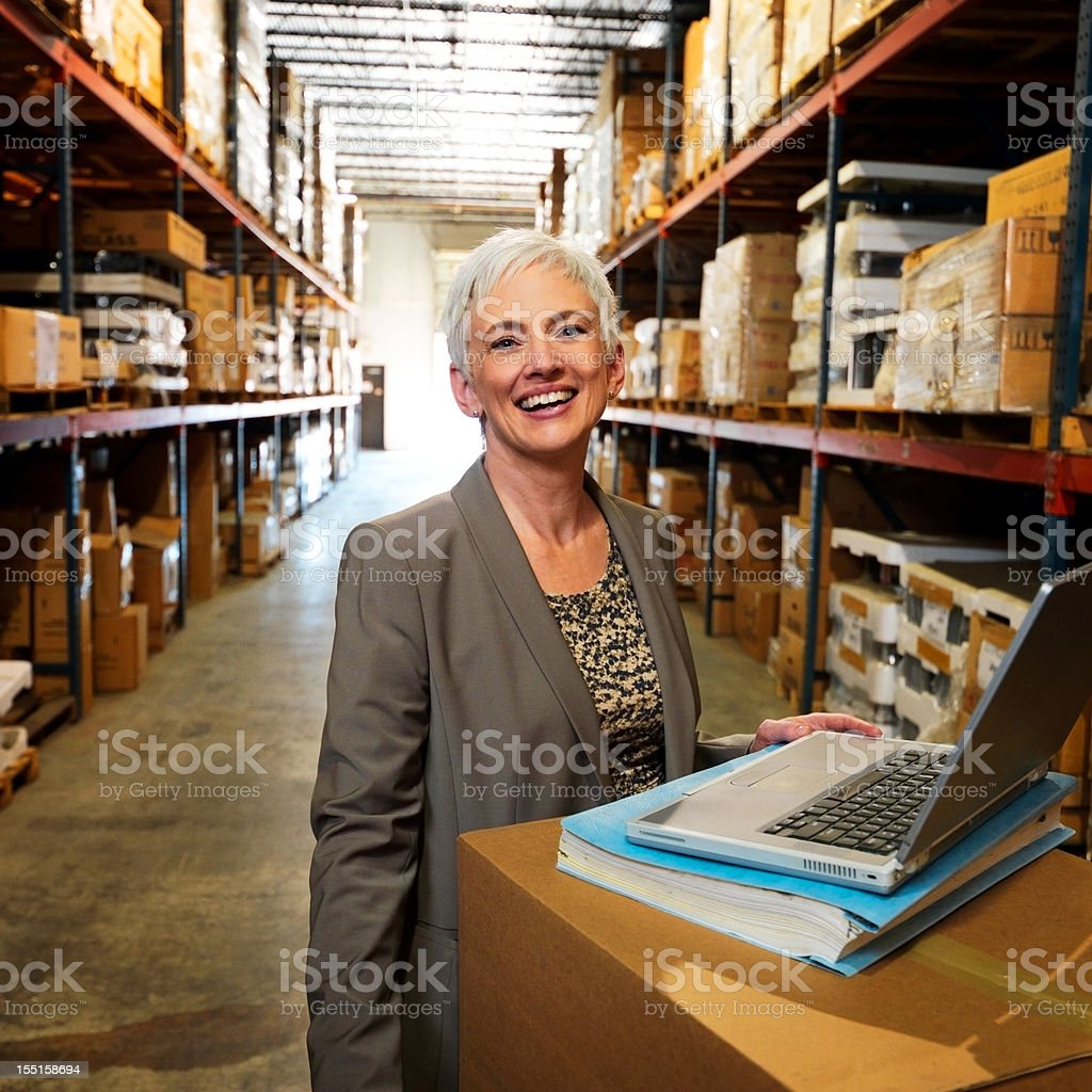 Portrait of Warehouse Businesswoman Smiling royalty-free stock photo