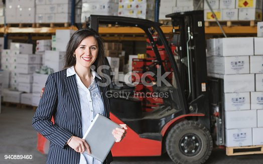 915900234istockphoto Portrait of warehouse manager woman using tablet 940889460
