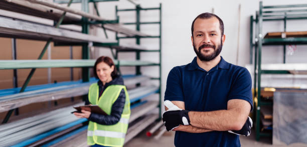 Portrait of warehouse worker looking at camera stock photo