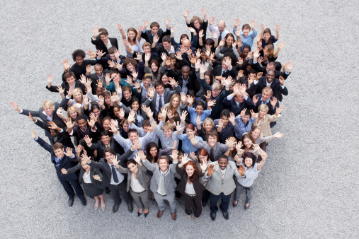 istock Portrait of waving business people 151811135
