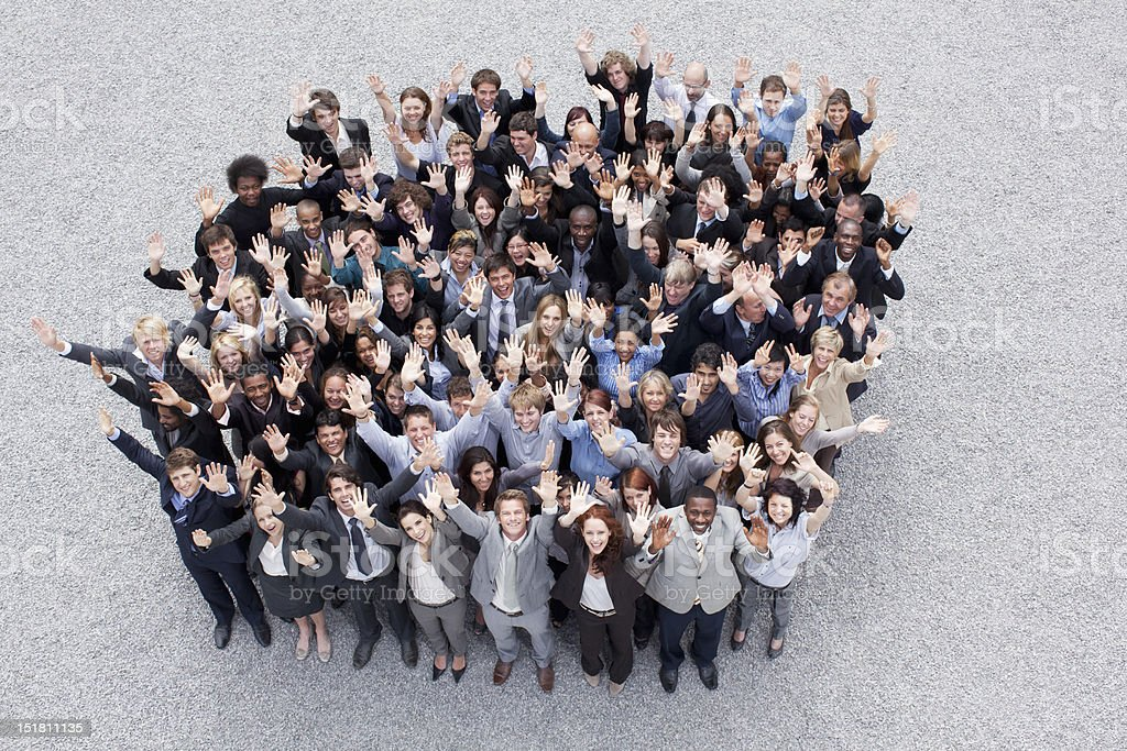 Portrait of waving business people stock photo