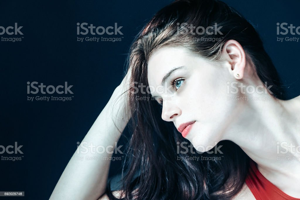 portrait of white woman in darkness stock photo