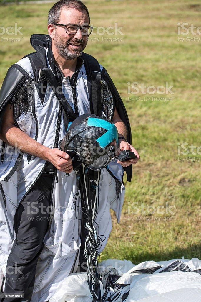Portrait of wingsuit jumper in mountain meadow stock photo