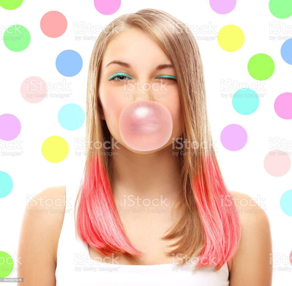 Portrait of winking happy girl with chewing gum stock photo