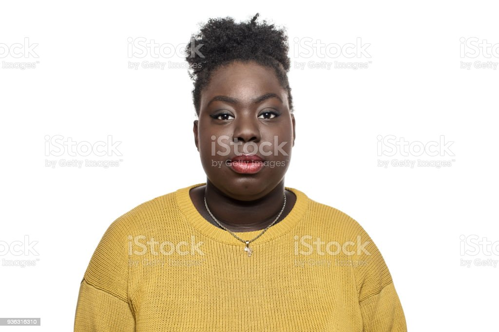 Portrait of woman against white background stock photo